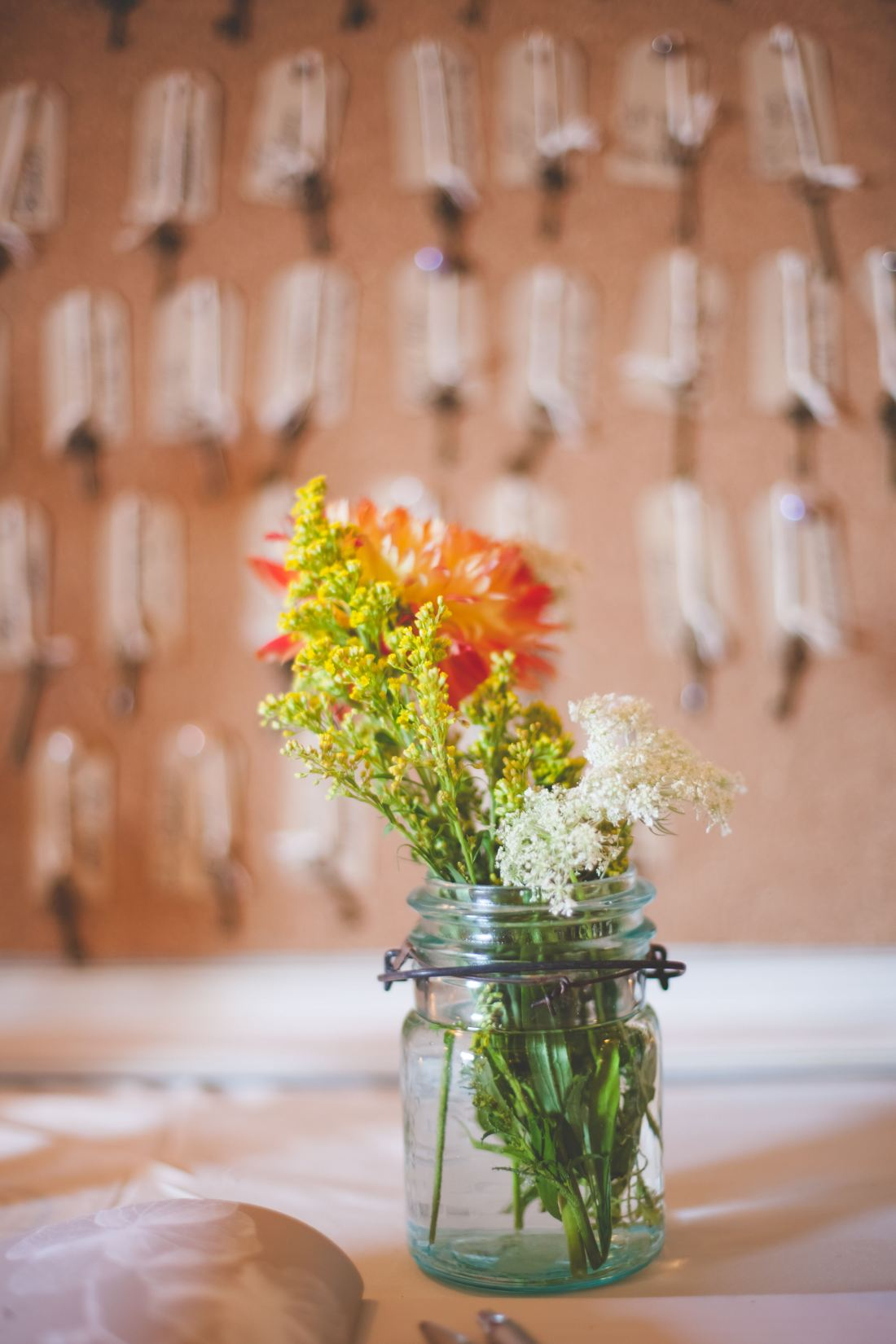 Wildflowers in a jar are pretty, laid back, and affordable.