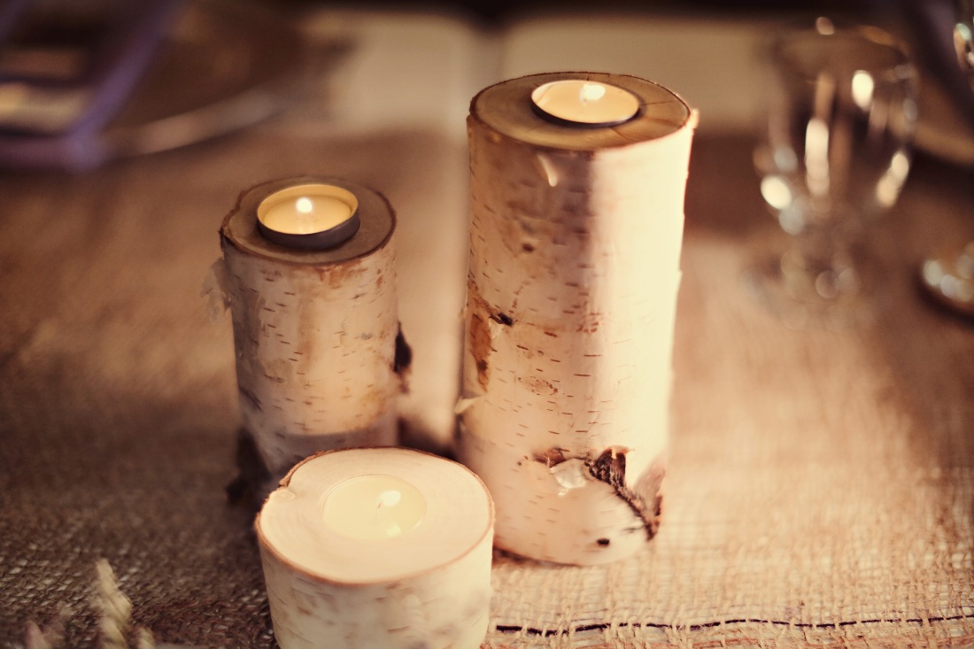 A trio of birch tree candle holders offers nature inspired ambiance.