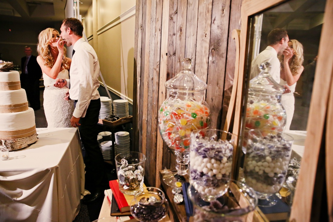 We set our barnwood wall up to use as a background not only for the candy buffet but for the cake as well. Which works wonderfully for photos of the bride groom during their cake moment.