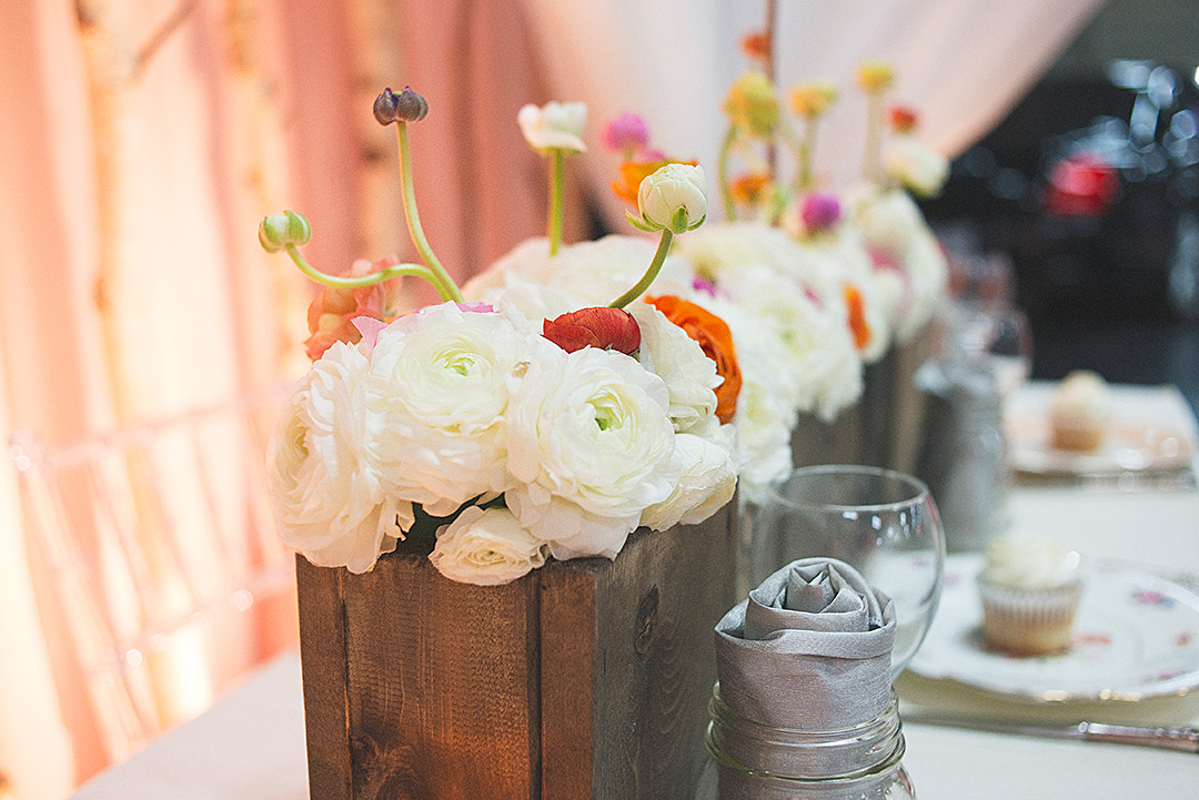 A wooden box overflowing with flowers, perfectly embodies rustic elegance.