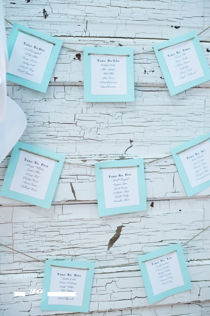 Seating chart displayed in crisp mint on a charming door.