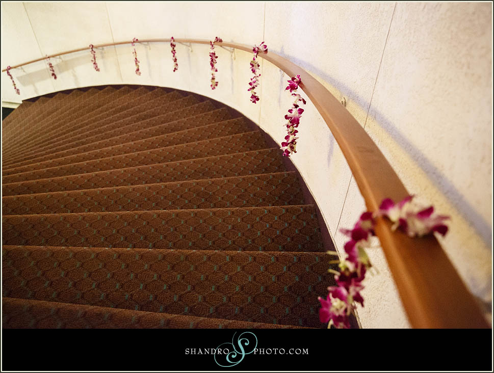 Orchids dripped over the staircase railing leading guests up to the reception room.